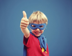 boy-in-superhero-costume-blue-background